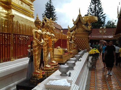 Golden Buddha statues around the chedi at Wat Doi Suthep