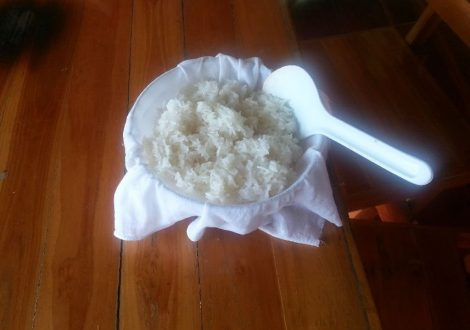 Stirring the sticky rice after cooking