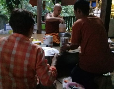 Giving alms to the monks