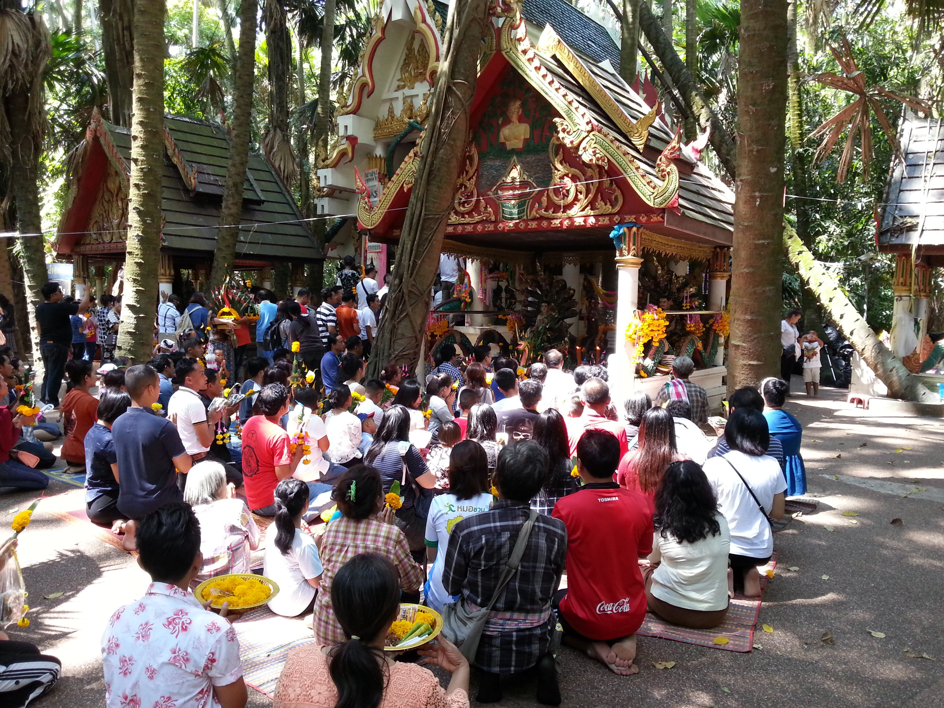 Receiving a blessing at Wat Kham Chanot
