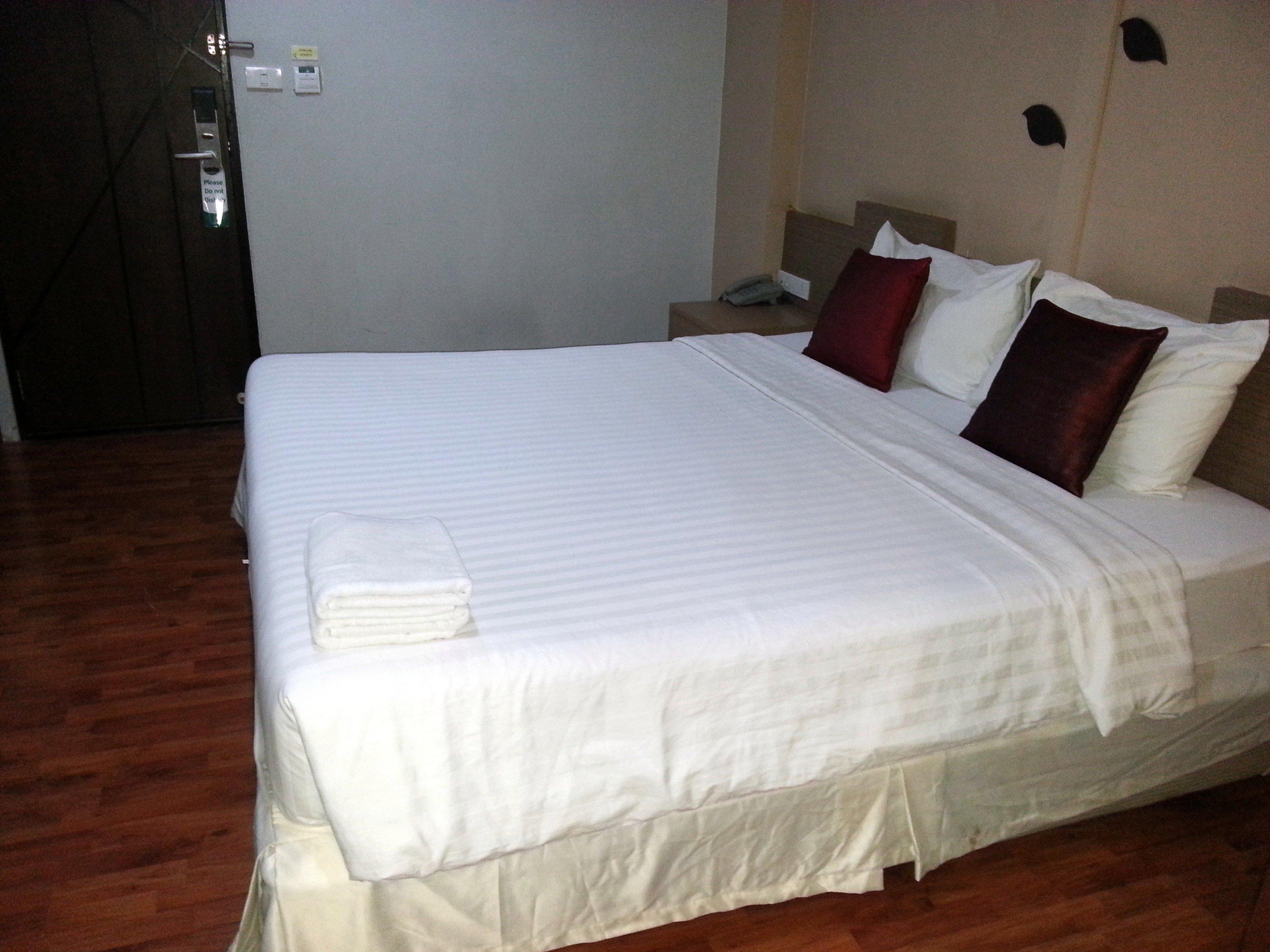 Bed at SF Biz Hotel