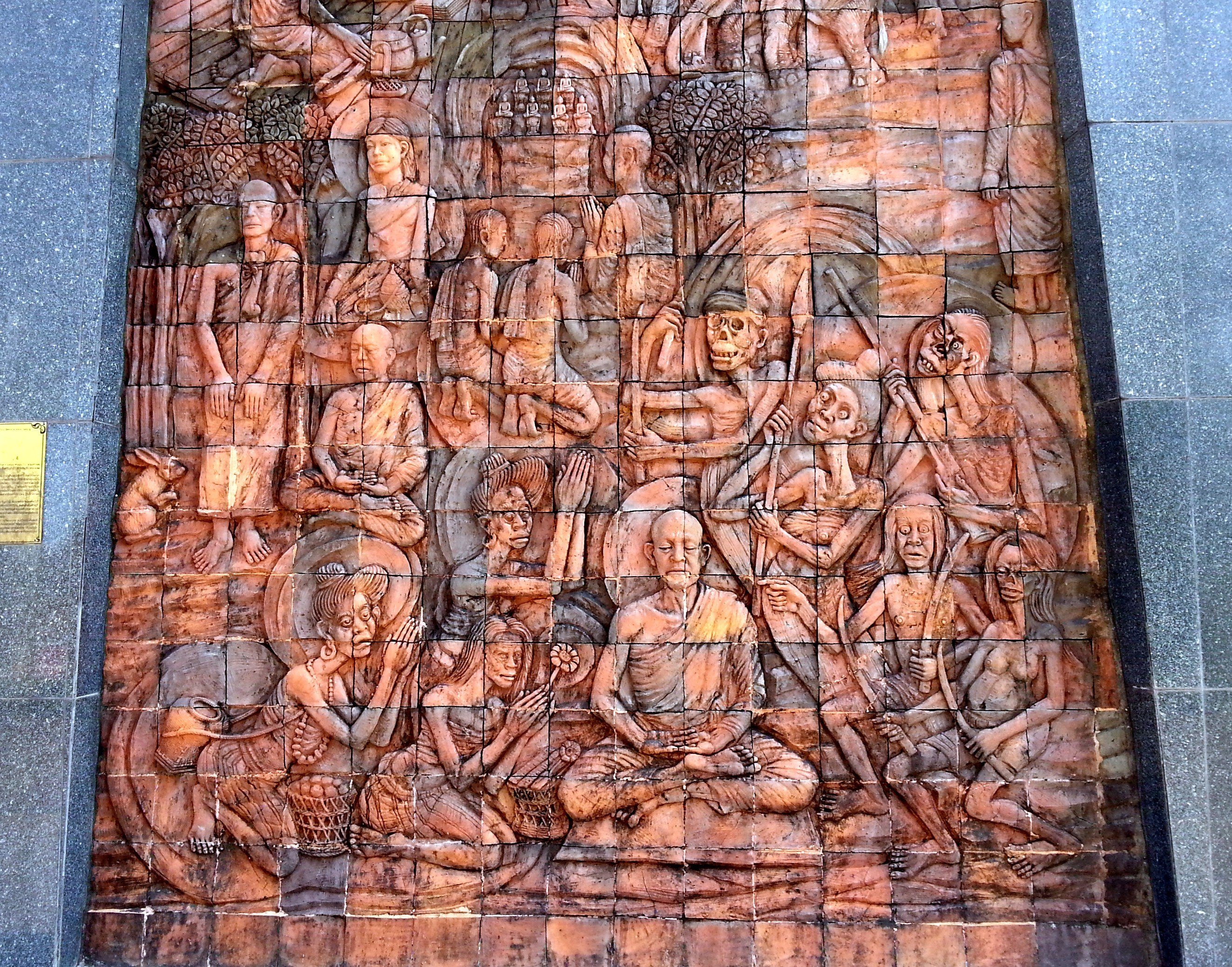 Relief on the chedi at Wat Phu Tok
