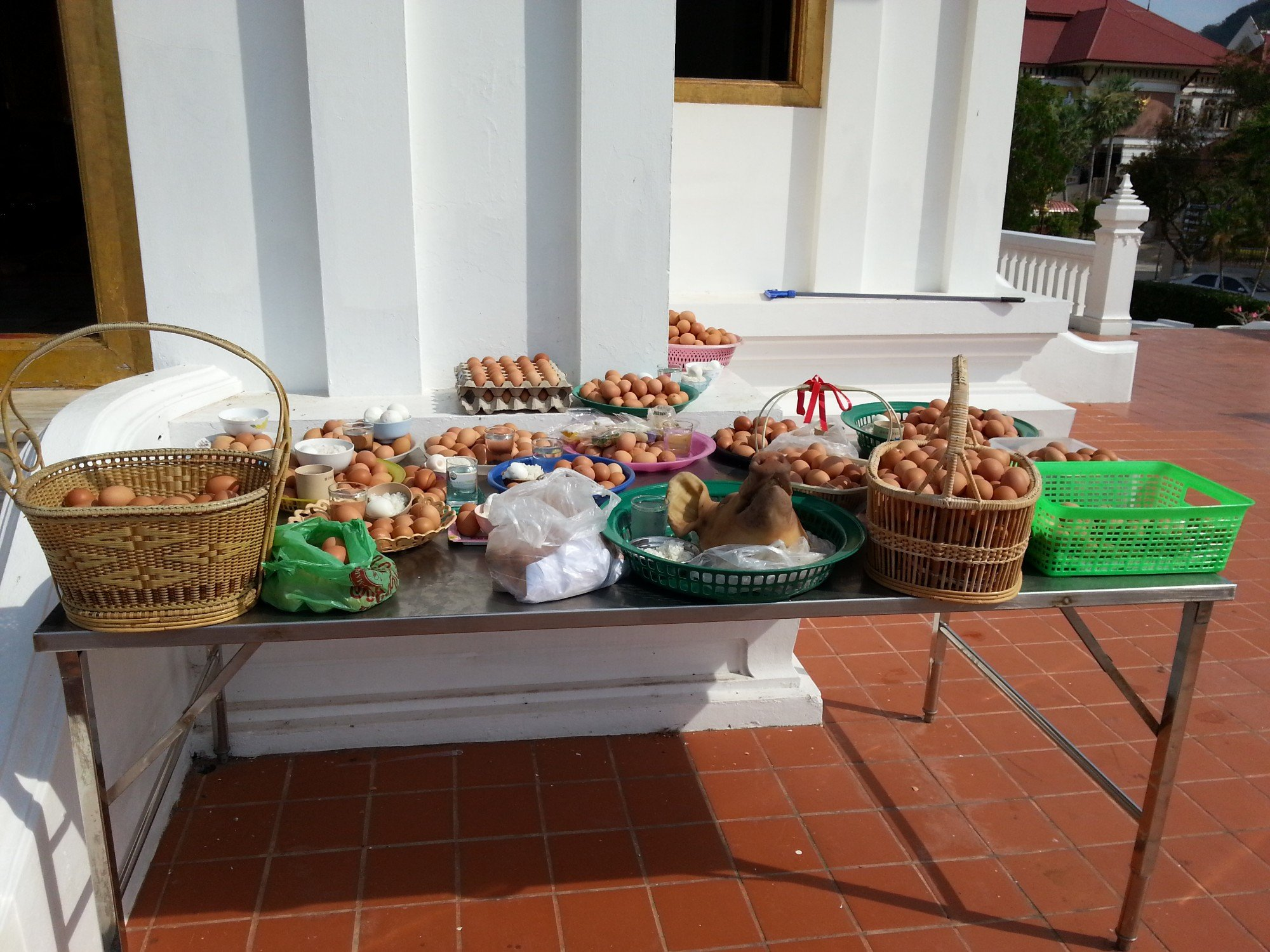 Eggs left as offerings to the Phra Phuttha Nirokhantrai Chaiwat Chaturathit