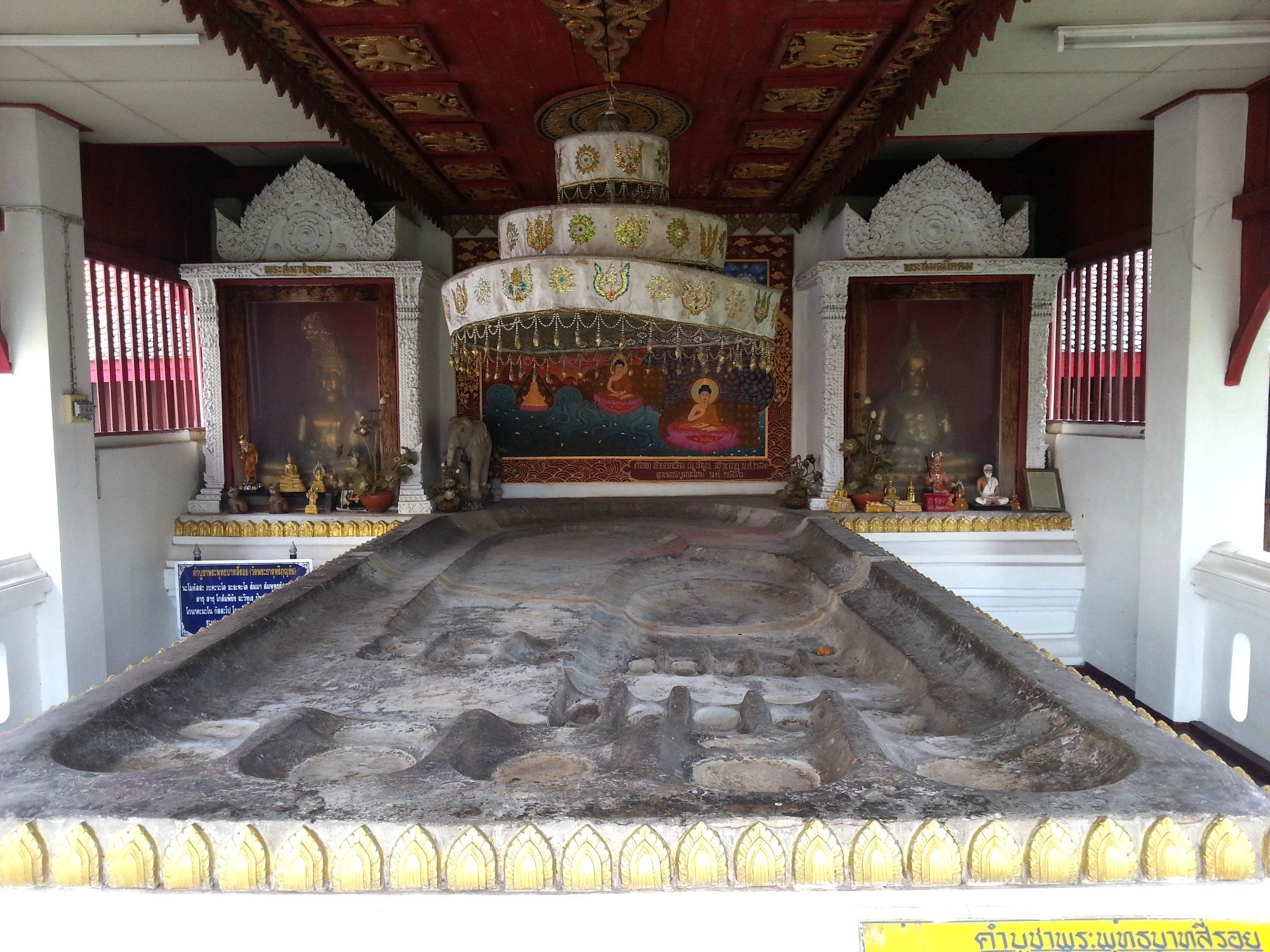 Buddha footprint at Wat Phra That Hariphunchai