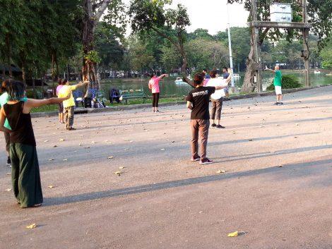 People practising Tai Chi in Lumphini Park