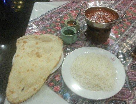 Curry, rice and nan bread at Akbar Restaurant